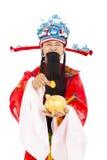 Dios de la riqueza que sostiene la moneda y la hucha de oro Foto de archivo libre de regalías