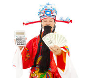 Dios de la riqueza que sostiene una máquina y un dinero del cálculo Foto de archivo libre de regalías