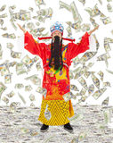 Dios de las riquezas de la parte de la riqueza y la prosperidad con el dinero llueven Imágenes de archivo libres de regalías