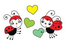 Dios rojo del amor de dos mariquitas con la primavera de los corazones - Fotografía de archivo libre de regalías