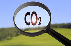 Dioxide. Magnifying glass with the word dioxide on blurred nature background. Searching dioxide concept Stock Photo