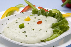 Dip. Coriander dip with sweet peppers and lettuce royalty free stock photo