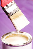 Dip brush into the paint. Stock Photography