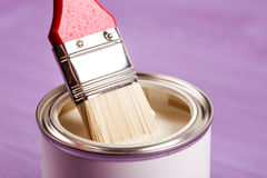Dip brush into the paint. Royalty Free Stock Photos