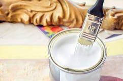 Dip brush white paint closeup Stock Image