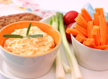 Dip with carrots Stock Image