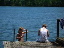 A Dip in the Lake. A young woman and man preparing to take a dip in a lake Stock Photography