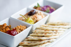 Dip platter with pita. Harissa hummus, feta, ajvar and pita bread royalty free stock photos