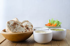 Dip Selection Bowls with Crudites and Mini Pittas Stock Images