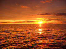The dip of the sun. The sun hides under the horizon by painting a picture of a natural orange color Royalty Free Stock Photography