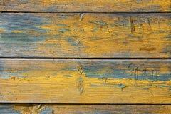 Dipinto fondo di legno giallo e blu fotografia stock libera da diritti