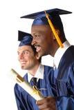 Diplômés avec le diplôme photo libre de droits