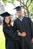 Diplômés d'homme et de femme Photo libre de droits