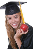 Diplômée de femelle avec la pomme Photographie stock libre de droits