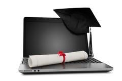 Diplom och bärbar dator Arkivbild