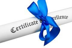 Diplom som binds med strumpebandsorden på bakgrund arkivfoto