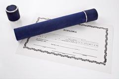 Diplom ut ur röret arkivbilder
