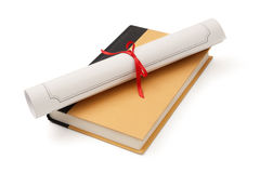 Diploma and book Stock Images