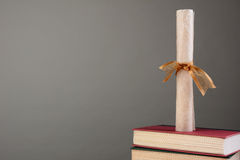 Diploma on Books with Copy Space Stock Image