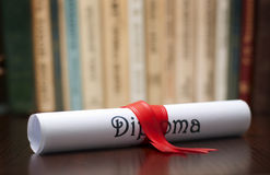 Diploma and books Royalty Free Stock Images