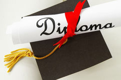Diploma and cap Royalty Free Stock Image