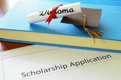 Diploma and cap Stock Photography