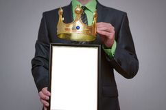 Diploma or certificate. Winner blank diploma or certificate mockup in businessman hand. Man is holding a blank photo frame with copy space for human face and a Royalty Free Stock Photos