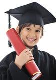 Diploma che si laurea il piccolo bambino dell'allievo Fotografia Stock Libera da Diritti