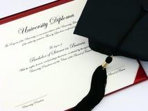 Diploma de la universidad Foto de archivo libre de regalías