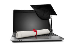 Diploma e computer portatile fotografia stock