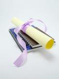Diploma en notaboeken Stock Fotografie