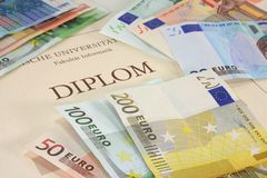 Diploma with euro notes Royalty Free Stock Images