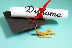 Diploma and grad cap Royalty Free Stock Image