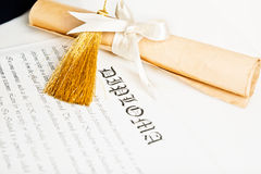 A diploma and grad hat represent Royalty Free Stock Photography