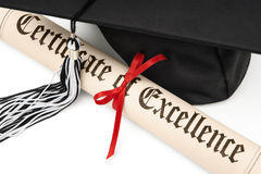 Diploma and graduation cap. Certificate of excellence and graduation cap on white background Stock Photography