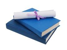 A diploma over blue books Stock Photos
