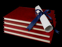 Diploma over books Stock Image