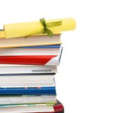 A diploma over  books Stock Image
