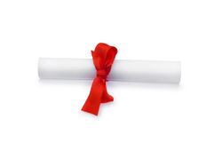 Diploma with red ribbon. Isolated on white Stock Images