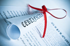 Diploma with red ribbon. Blue Stock Image