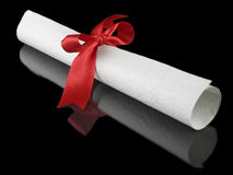 Diploma with red ribbon Royalty Free Stock Photos