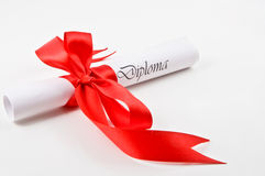 Diploma with red ribbon Stock Photo