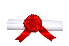 Diploma with red ribbon. Isolated on white Stock Image