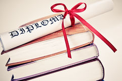 Diploma with red ribbon on books. Diploma with red ribbon and books Royalty Free Stock Images