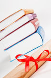 Diploma and books Stock Images
