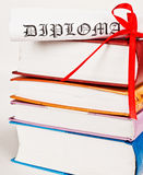 Diploma with ribbon and books Royalty Free Stock Images