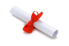 Diploma with red ribbon isolated. On white Stock Images
