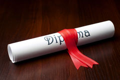 Diploma. With red ribbon on the table Royalty Free Stock Image