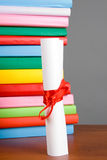 Diploma and stack of books Royalty Free Stock Photography