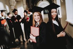 Diploma. Standing. Corridor. Girls. Happiness. stock photos